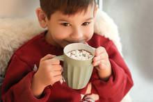 Cute Little Boy Drinking Hot C...