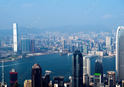 Fotobehang Hong-Kong Hong Kong cityscape with victoria harbour and large group of tall buildings.