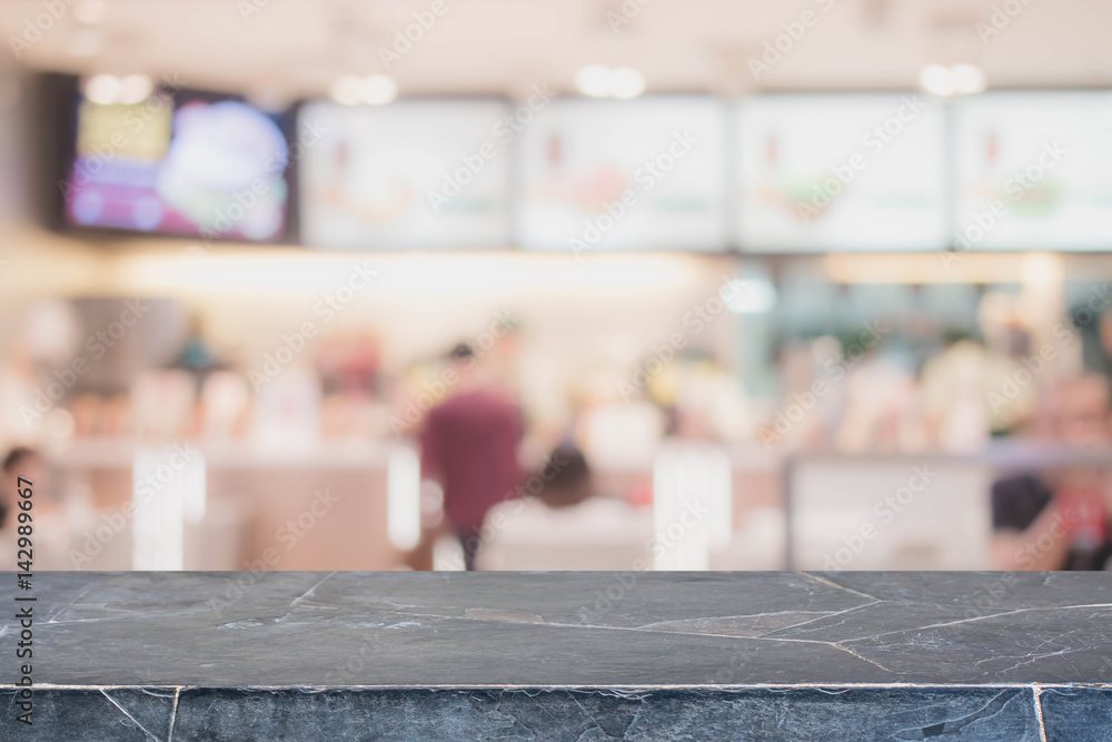 Fototapety, obrazy: Black Stone table top and blurred restaurant interior background with vintage filter - can used for display or montage your products.