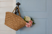 Basket With Flowers Hanging On...