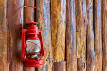 Red Oil Lamp Hanging On Wooden Wall