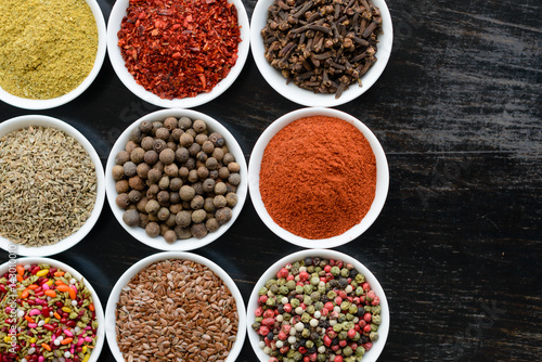Fototapety, obrazy: Various spices on wooden spoons. Food ingredients