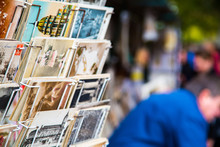 Selling Old Vintage Postcards On The Strets Of Paris, France.