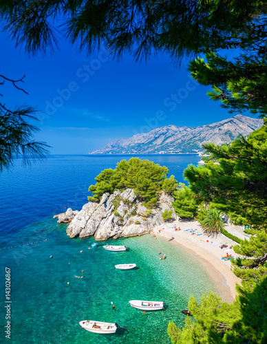 Poster Beach Podrace beach in Brela through pine trees