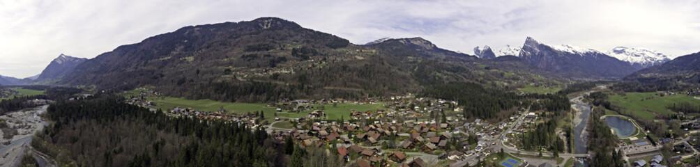 Fototapeta na wymiar Aerial Shots of a Spring Snow Melt River and Valley
