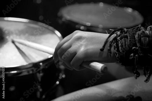 Fotografia, Obraz Girl rocker plays on drum set