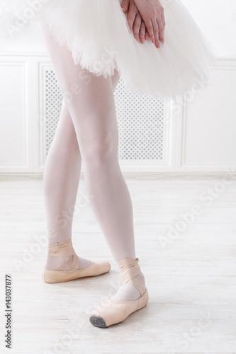 Ballerina legs closeup in fourth position