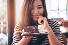 A Beautiful Asian Woman Holding Brownie Cake And Whipped Cream With Feeling Happy And Good Lifestyle In The Modern Cafe