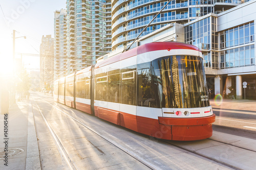 Modern tram in Toronto downtown at sunset