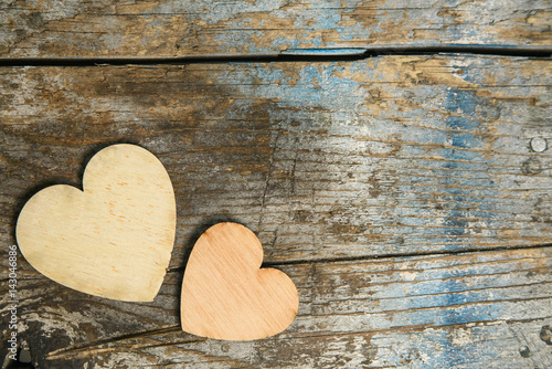 Foto-Tapete - valentines day or wedding banner with tho hearts and copy space. love concept on shabby chic wooden background (von stillforstyle)