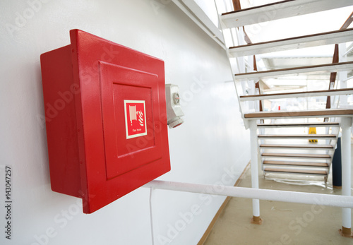 Photo  Fire hose cabinet on a ship.