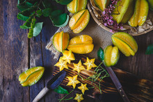 Fresh Starfruits On The Old Wood