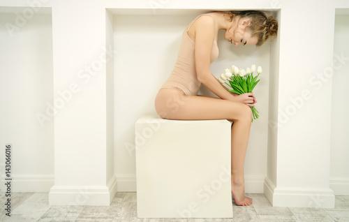 Tela  tenderly hugging flowers