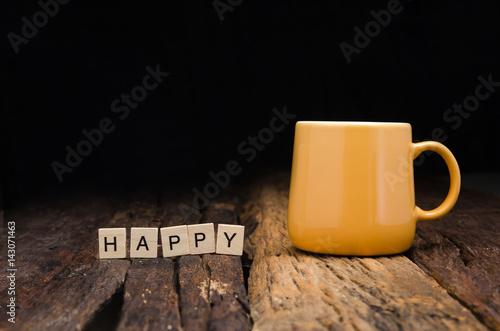 Yellow ceramic empty mug and bamboo letter box arranged