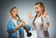 The Boy Plays The Bassoon And The Girl Applauds