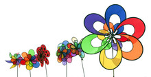 A Row Of Colorful Spinning Pinwheels. Isolated.
