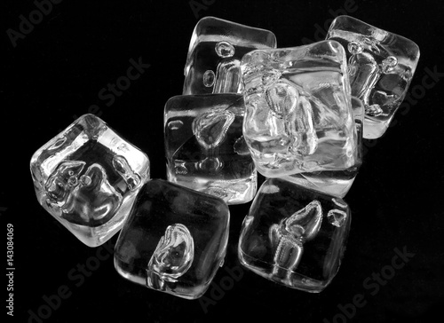 Photo  Ice cubes on a black background.