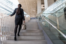 Business Woman Going Up The St...