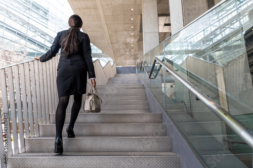 business woman going up the stairs Wallpaper Mural