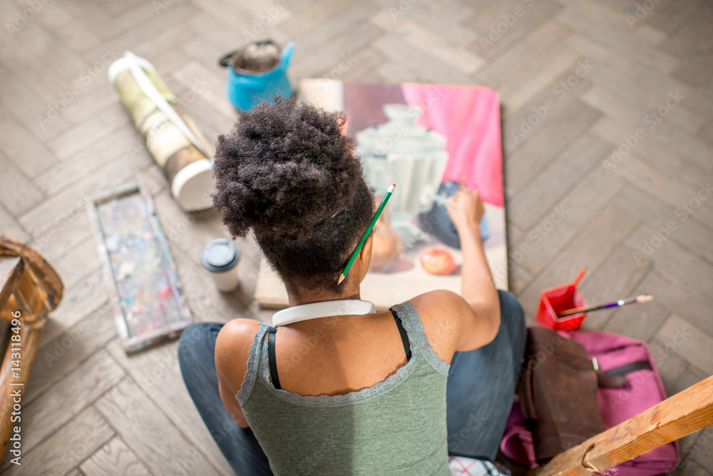 Fototapety, obrazy: Female student painting still life sitting on the floor. View from above