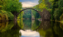 Autumn, Cloudy Evening Over Devil's Bridge In The Park Kromlau, Germany