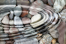 Water Ripples Over The Stone Pebbles
