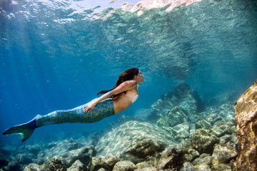 Mermaid swimming underwater...