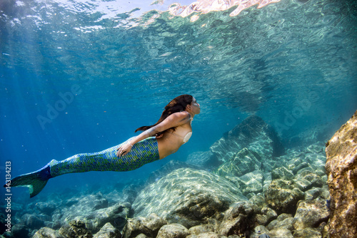 Mermaid swimming underwater...
