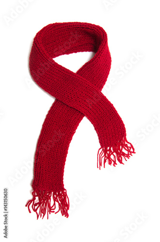 Valokuva Red knitted scarf on a white background.