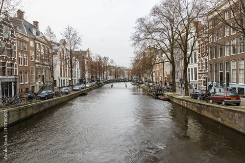 Photo  Amsterdam, March 17, 2017: Canals and house view from Amsterdam, where city of b