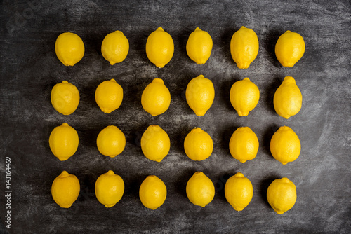 Obraz na plátne  Picture of lemons on grey background