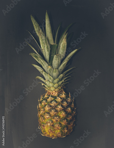 Fototapety, obrazy: Pineapple on a black background