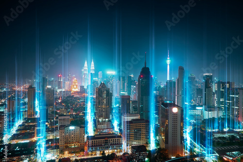 Deurstickers Kuala Lumpur The network light came out from the ground ,modern city with wireless network connection concept , abstract communication technology image visual .