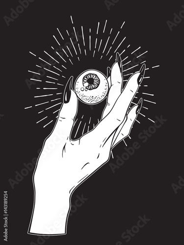 Human eyeball in female hand isolated Wallpaper Mural