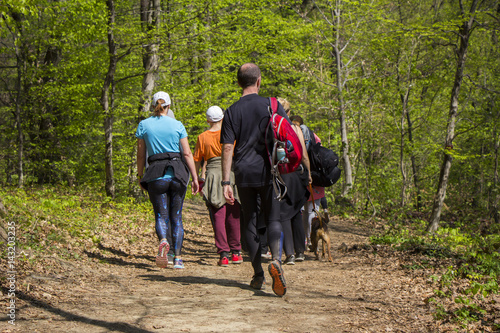 Foto  Group of people walking by hiking trail