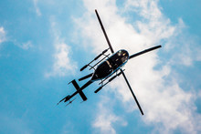 Helicopter In The Blue Sky