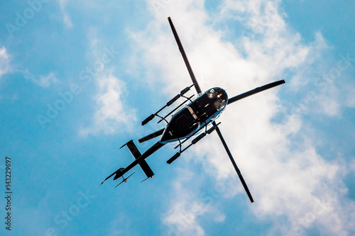 Tuinposter Helicopter Helicopter in the blue sky