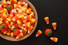 Bowl With Tasty Halloween Candies On Dark Background, Closeup