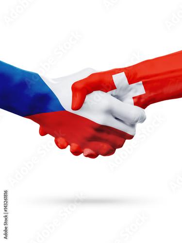 Photo  Flags Czech Republic, Switzerland countries, partnership friendship handshake concept