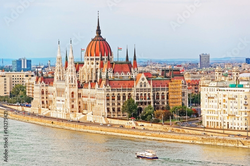 Aluminium Prints Budapest Water boat at Danube River with Hungarian Parliament Building