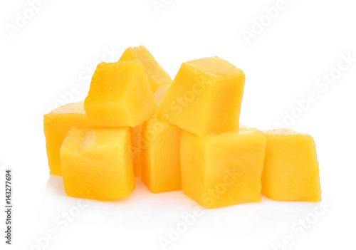 fresh mango cubes isolated on white background
