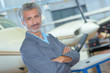 Portrait of middle aged man in aircraft hangar