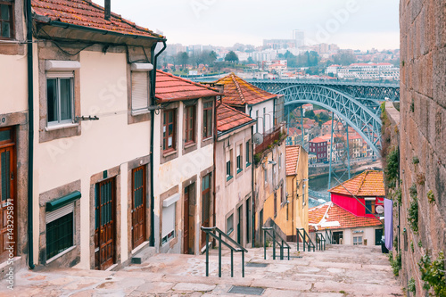 Fototapeta Traditional old houses in Ribeira and stairs down to the river Douro, Dom Luis I