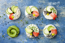 Vegan Sushi Donuts Set With Pickled Ginger, Avocado, Cucumber, Chives, Nori And Sesame On Blue Background. Sushi-food Hybrids Trend. Overhead, Top View, Flat Lay.