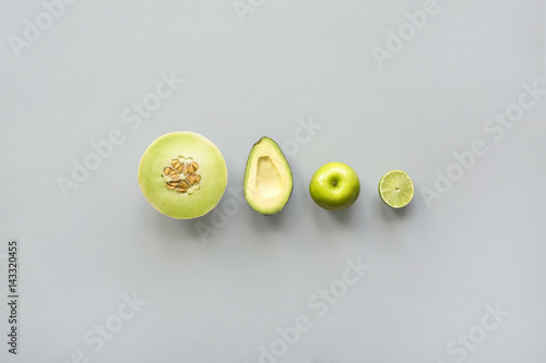 Green fruit against plain background, studio shot Poster