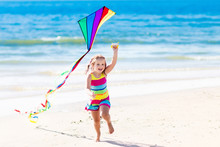 Child Flying Kite On Tropical ...