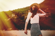 Beautiful Smiling Woman Posing In The Nature With Sunglasses And Hat.