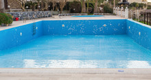 A Swimming Pool Empties At The...