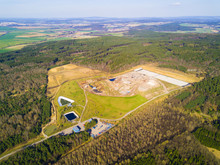 Aerial View Of Municipal Landfill Site. Typical Waste Treatment Technology Top View. Garbage Pile And Toxic Lakes With Dangerous Chemicals In Trash Dump.