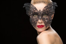 Beautiful Woman In A Carnival Mask On Black Background